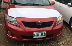 Red 2011 Toyota Corolla Le for sale