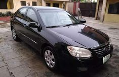 Clean kia cerato black for sale