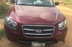 Hyundai Santa Fe 2009 red for sale