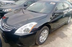 Super clean Nissan Altima 2012 Black color for sale