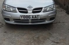 Nissan Almera 2004 Tino Silver color for sale