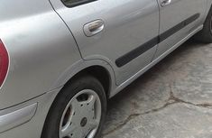 Nissan Almera 2004 Tino Silver color for sale