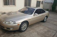 1997 Gold Lexus SC for sale in Abuja