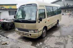 Toyota Coaster 2010 Gold for sale