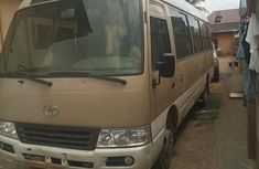 Toyota Coaster 2015 Gold color for sale