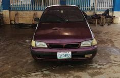 Fairly used Toyota Carina 1998 E Red color for sale