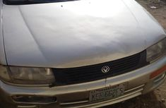 Mazda 323 1999 Gold for sale