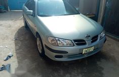 A Nine Months used Nissan Almera 2004 Blue color for sale