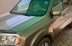 Honda Pilot 2010 in mint condition Gold color for sale