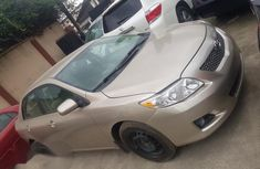 Low mileage Toyota Corolla 2008 Gold color for sale