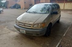 Well used and maintained Toyota Sienna 1999 Gold color for sale