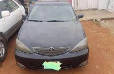 Clean black 2003 Aston Martin Camry automatic for sale at price ₦980,000