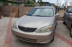 Very neat Toyota Camry 2004 Gold color for sale