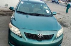 The car is Tokunbo Toyota Corolla 2009 Green for sale