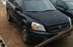 Best priced black 2003 Audi Pilot automatic at mileage 124