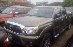 Need to sell black 2012 Aston Martin Tacoma at mileage 10 in Lagos