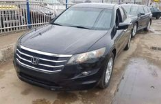 Selling black 2011 Audi Accord automatic in good condition in Lagos