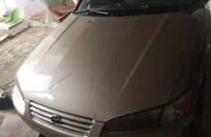 Very clean first body Toyota Camry 2000 Gold color for sale