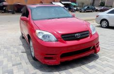 A clean, foreign used  Toyota Matrix 2004 Red color for sale