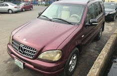 Clean and neat red 2001 Mercedes-Benz ML 320 for sale