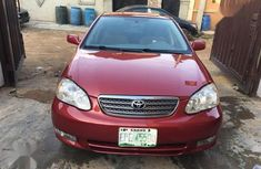 Clean and neat red 2004 Toyota Corolla sedan at price ₦1,320,000 in Lagos