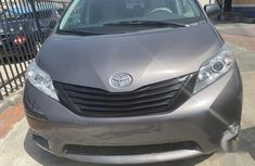 Need to sell cheap used grey/silver 2012 Toyota Sienna automatic in Lagos