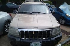 Selling gold 2004 Jeep Grand Cherokee at cheap price