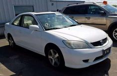 Need to sell cheap used white 2004 Honda Civic at mileage 26,441