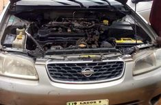 Sell gold 2002 Nissan Sentra sedan automatic at mileage 127,575