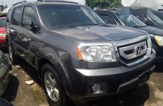Well maintained grey/silver 2010 Honda Pilot at mileage 68,443 for sale