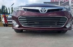 Need to sell cheap used red 2014 Toyota Avalon at mileage 445,114