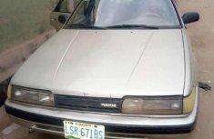 Grey/silver 1998 Mazda 626 car sedan manual in Lagos