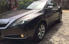 Need to sell cheap used brown 2012 Acura ZDX sedan