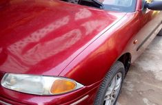 Need to sell cheap used red 2000 Rover 214 at mileage 198,542