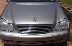 Selling grey/silver 2003 Mercedes-Benz C230 automatic at price ₦2,100,000