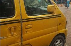 Well maintained yellow 2005 Suzuki Carry at mileage 150,000 for sale