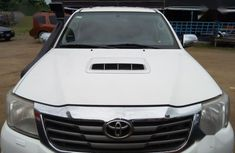 White 2012 Toyota Hilux car at mileage 157,762 at attractive price