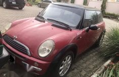 Best priced red 2002 Mini Cooper suv / crossover at mileage 100,000