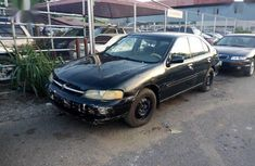 Selling black 1998 Nissan Altima at cheap price