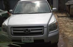 Need to sell high quality grey/silver 2007 Honda Pilot suv / crossover automatic
