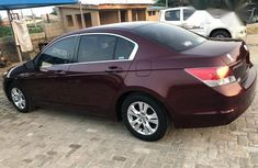 Need to sell cheap used red 2010 Honda Accord sedan in Lagos