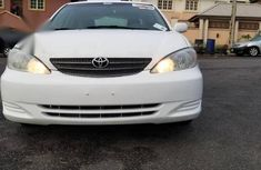 Need to sell high quality white 2003 Toyota Camry sedan automatic