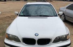 Selling white 2003 BMW 325i sedan in good condition