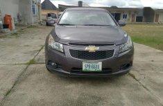 Selling grey/silver 2010 Chevrolet Cruze sedan automatic in Yenagoa