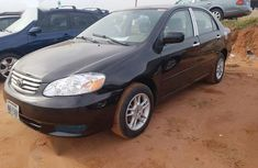 Sell well kept black 2003 Toyota Corolla automatic at mileage 12,435