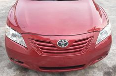 Need to sell red 2007 Toyota Camry sedan at price ₦2,300,000