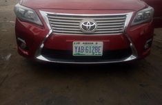 Sell well kept red 2009 Toyota Corolla sedan at price ₦2,700,000