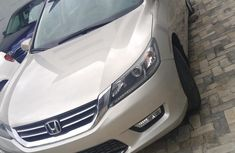 Gold 2014 Honda Accord car automatic at attractive price in Ikeja