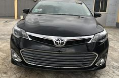 Need to sell high quality black 2014 Toyota Avalon sedan automatic in Lagos