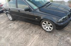 Very sharp neat used 2003 BMW 320i manual for sale in Ikeja